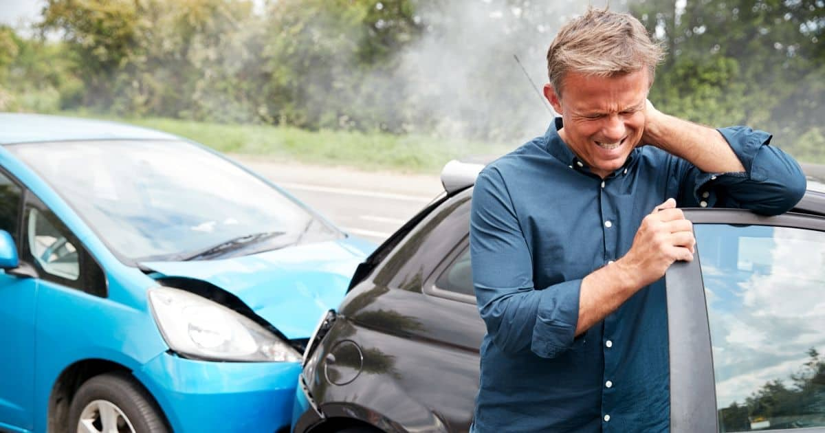What are the symptoms of whiplash, and how is it treated?